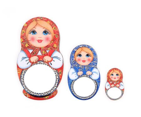 Souvenir (magnet) from Russia in the form of dolls isolated on white background.