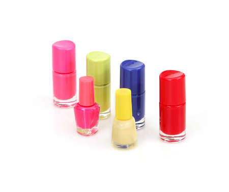 Mockup: Nail polishes bottles isolated on white background
