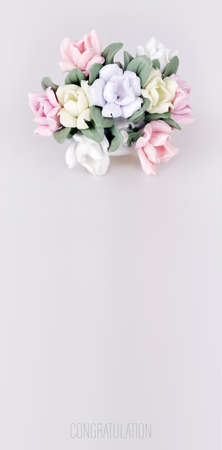 Composition with negative space. Porcelain basket with flowers isolated on white background 写真素材