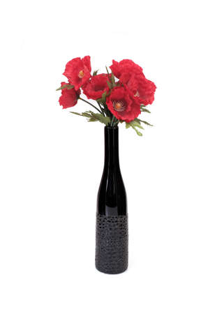 Bouquet of red flowers in a vase isolated on white background