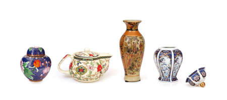 Chinese dishes (teapot, vase, casket) isolated on a white background