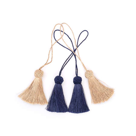 Blue and golden silk tassels isolated on white background for creating graphic concepts Banque d'images