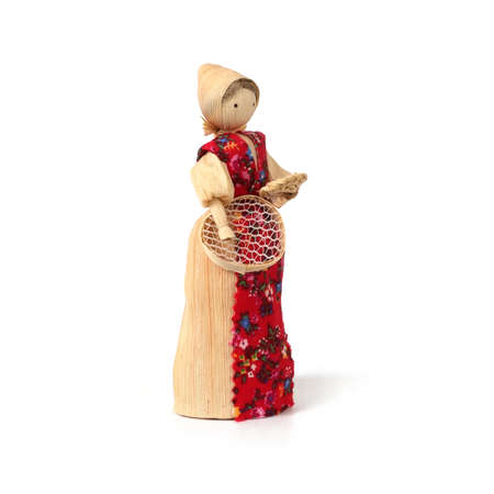 Straw souvenir doll in national costume isolated on a white background