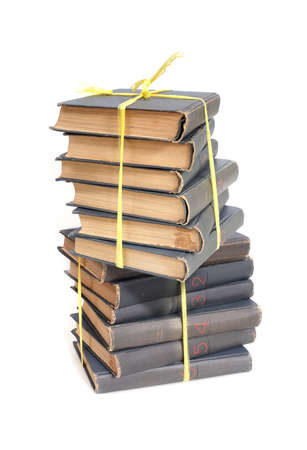 Stack of books in gray covers with white sheets isolated on a white background