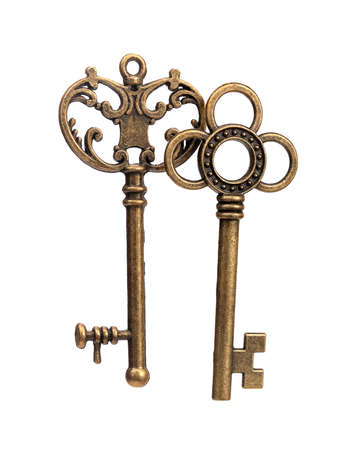 Old golden keys isolated on white background