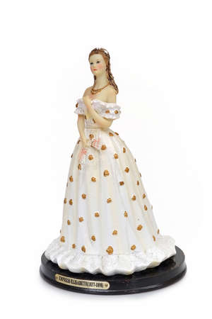 Souvenir figure of Austrian Empress Elisabeth isolated on a white background. The inscription is the name and the dates of her life