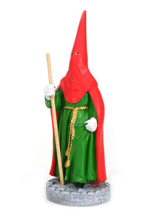 """Souvenir Spanish figurine """"Brother of a religious brotherhood in a cassock with a staff"""" isolated on a white background"""