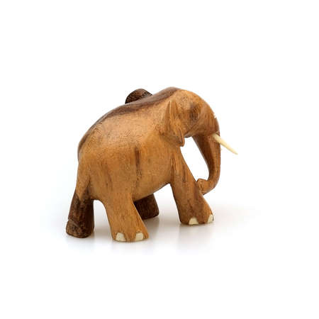 Wooden souvenir elephant made of wood and ivory isolated on a white background