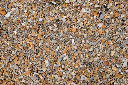 Sea pebbles. Small stones gravel texture background.Pile of pebbles, thailand.