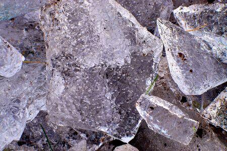Ice fragments on frozen lake water level. Banco de Imagens