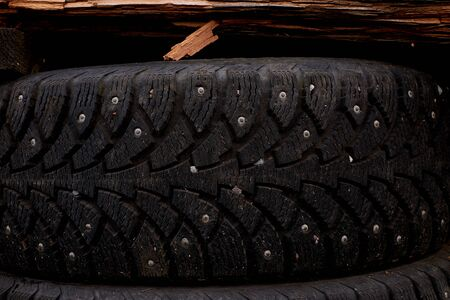 used winter tires on green grass