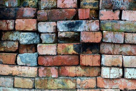 Old brick lies assembled in rows.