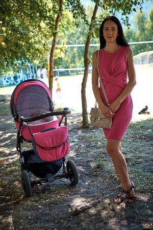 mom with a baby stroller Banco de Imagens