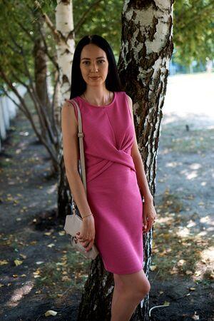 Young girl with dark hair in a fuchsia dress Banco de Imagens