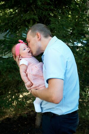 A father hugs his little daughter Banco de Imagens
