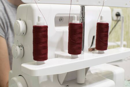 sewing machine for wrapping sections of textile materials
