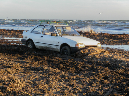 The car stuck on the seashore