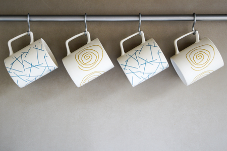 four cups with different ornament hanging in the kitchen