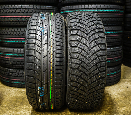 new winter tires with studs and without studs Stockfoto