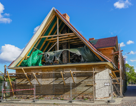 complete reconstruction of old wooden house in city