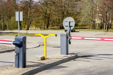 car parking with entry and exit control barriers, security system Reklamní fotografie