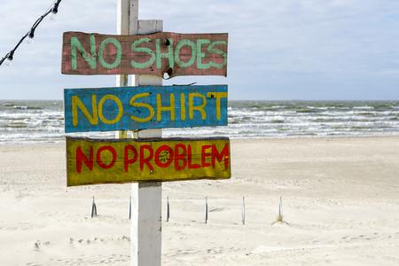 colorful inscription at the beach cafe, no shoes, no shirt, no problems Stock fotó