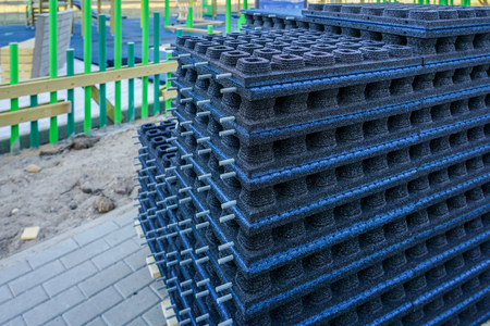 building a new modern childrens playground in the city, elastic rubber floor slabs