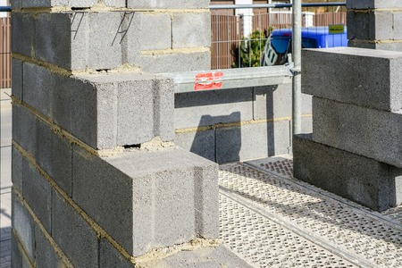 Concrete foundation and wall construction of a new house, view of construction site in preparation process Stock Photo