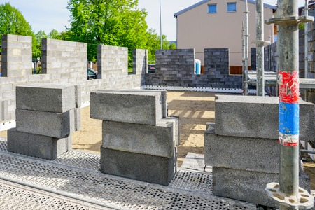 Concrete foundation and wall construction of a new house, view of construction site in preparation process Stock Photo - 123552434