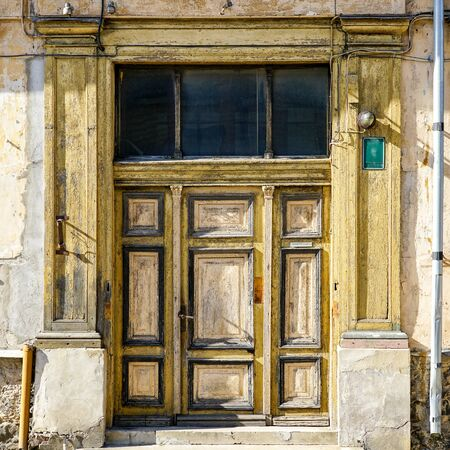 an old interesting three-piece wooden door in Liepaja