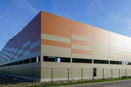 facade of new factory building made of thermo insulated aluminium cladding panels