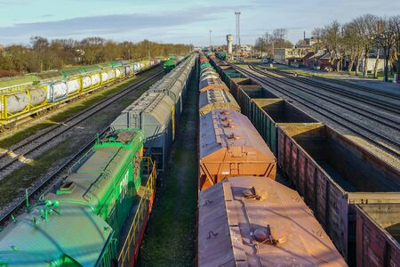 many freight train wagons at the railroad station