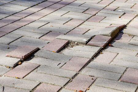 defective cobblestone pavement due to incorrectly prepared base Foto de archivo