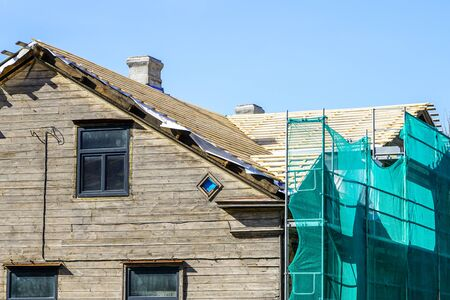 repair of two storey wooden house roof structures