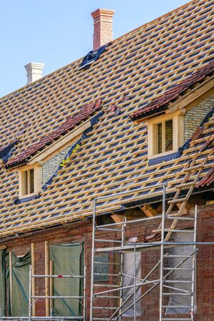 repair of the roof structures of a beautiful historic wooden house and replacement of clay tiles
