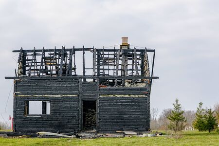 burnt down two storey wooden house in rural area