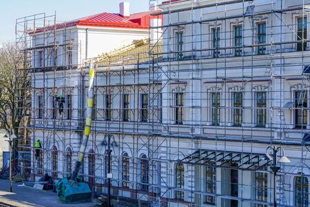roof repair of a historic building, restoration and painting of the facade