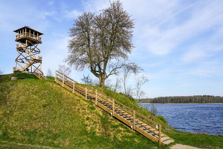a new wooden bird watching tower on top of a hill by the lake Banque d'images