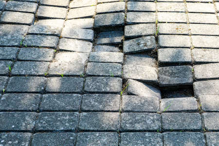 deformation of cobblestone pavement due to incorrectly prepared base Stock Photo