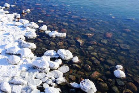 white snowy pebbles on the Baltic sea coast