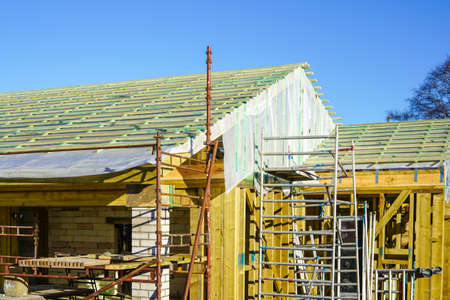 new modern wooden construction building in the construction process, roofing with anti-condensation film