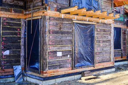 restoration of an old wooden house by numbering, dismantling, assembling and replacing the damaged elements