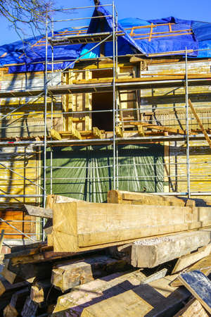a pile of used wooden building materials for reuse in a wooden house restoration site Stock fotó