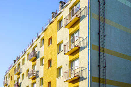 thermally insulated and visually restored apartment house facade on a background of blue sky Stock fotó