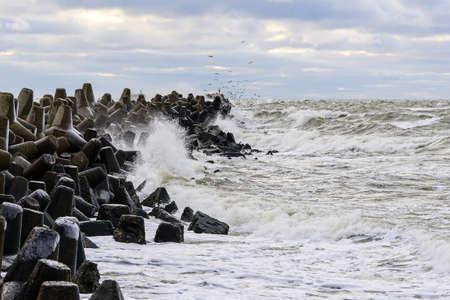 Stormy Baltic sea, port entrance concrete breakwater, Liepaja, Latvia