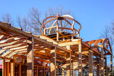 new wooden building frame with a round domed tower frame 版權商用圖片