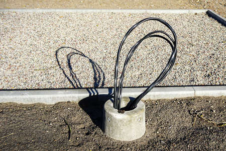 street lighting lantern pole base with supply cables at the street reconstruction construction site Stock fotó