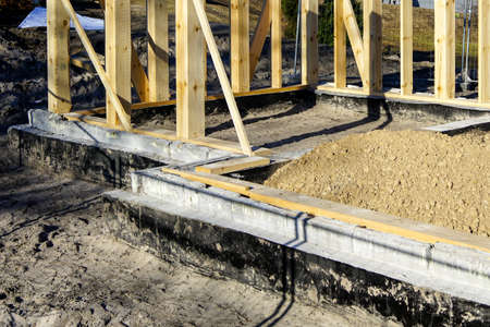 new modern wooden house frame concrete foundation waterproofing and damp proofing with bitumen membrane