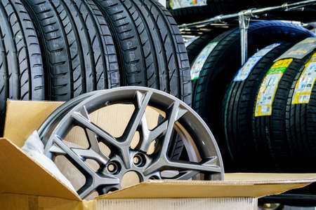 new stylish light alloy material wheel in a cardboard box on a background of new summer tires Stock fotó