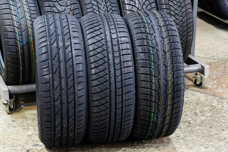 three new tires with different treads for summer, all season and winter with soft rubber